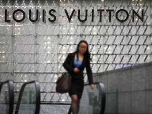 woman-walking-under-louis-vuitton-sign-in-china